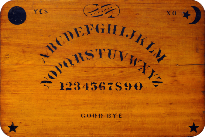 1280px-Ouija_board_-_Kennard_Novelty_Company.png